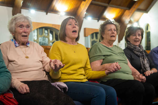 image of 4 people singing